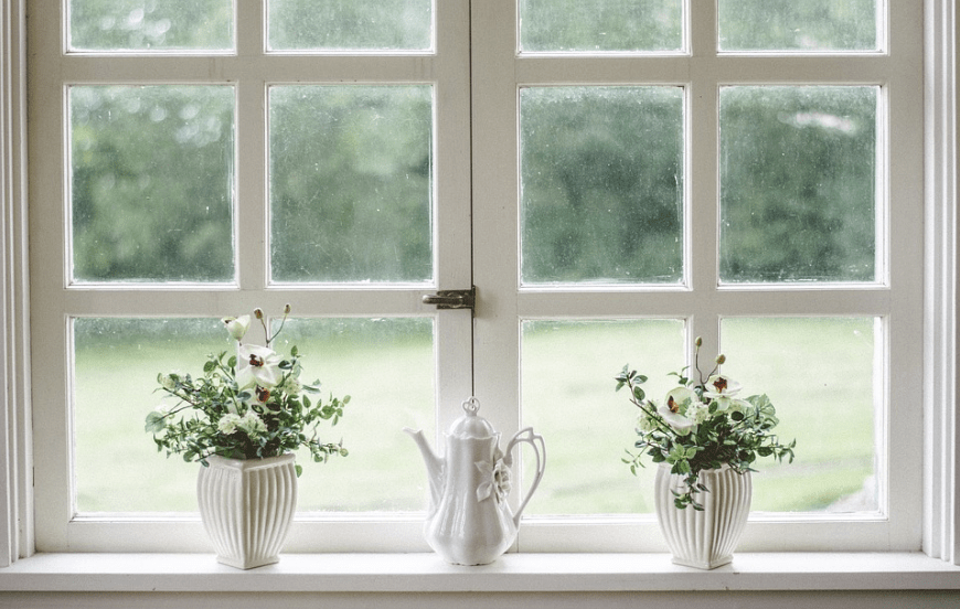 glass windows, windowsill, two flower vases, teapot