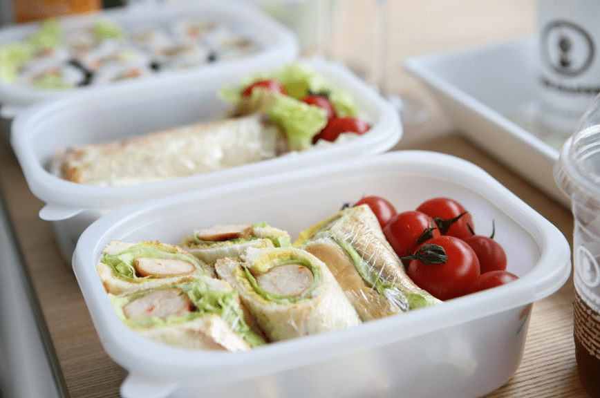 lunch boxes, sandwiches, cherry tomatoes